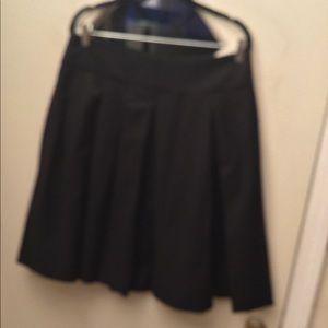 Black box pleated skirt